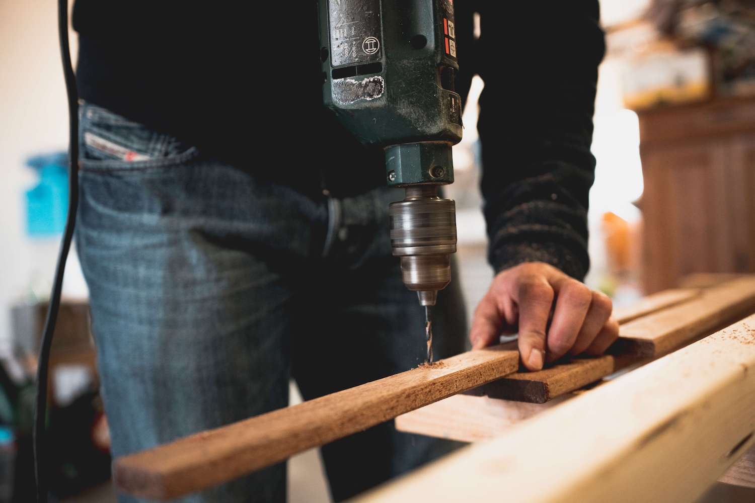 man-holding-wooden-stick-while-drilling-hole-1094767 (1)